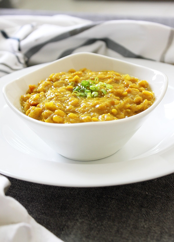 Close up image of chana dal in white bowl.