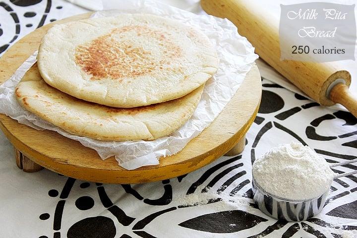 milk pita bread on rolling pin