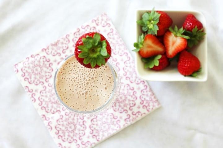 overhead shot of banana strawberry oats smoothie