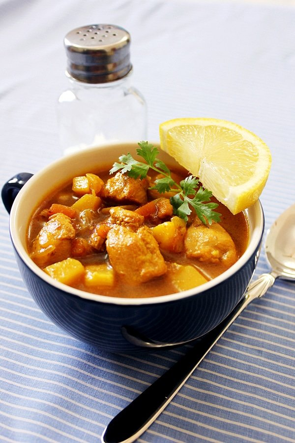 chicken veg stew served with a slice of lemon