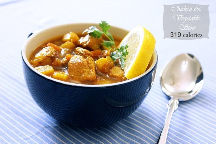 chicken veg stew served in a blue bowl.