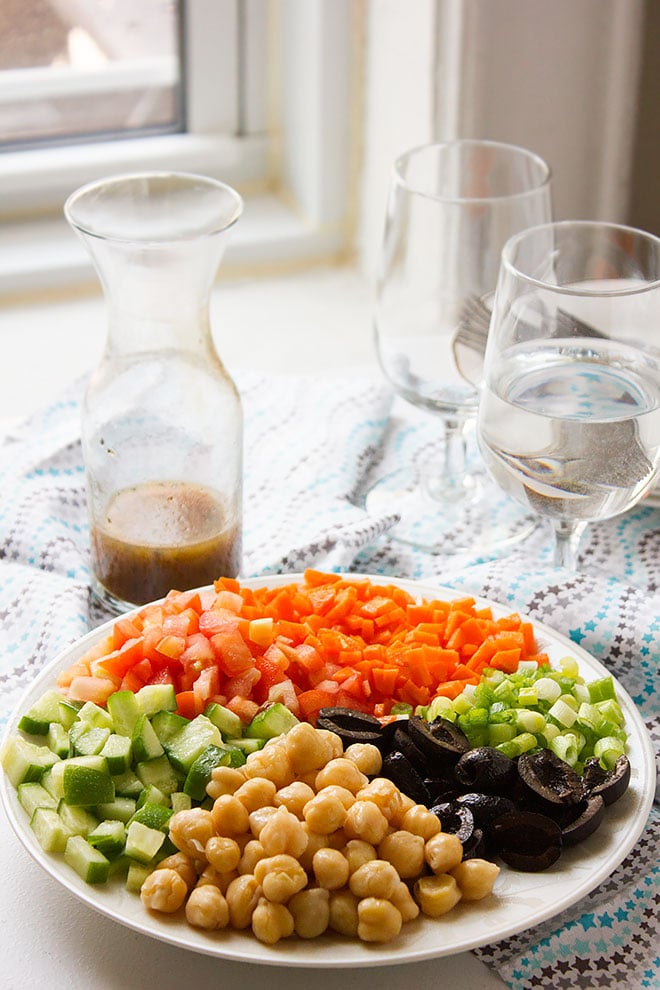 Chickpea Salad served in a plate and is ready for dressing. #salad #chickpeasalad #vegan #vegetarianrecipe #saladrecipe