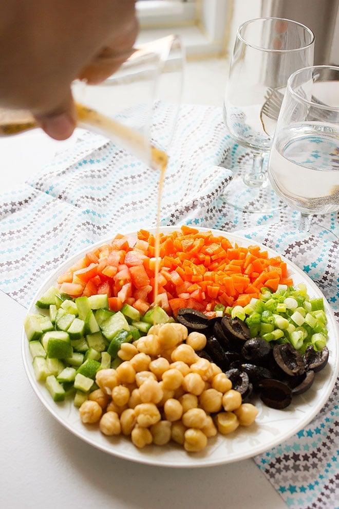 Pouring dressing over Chickpea Salad. #salad #saladrecipe #healthyrecipe #recipe #dressing