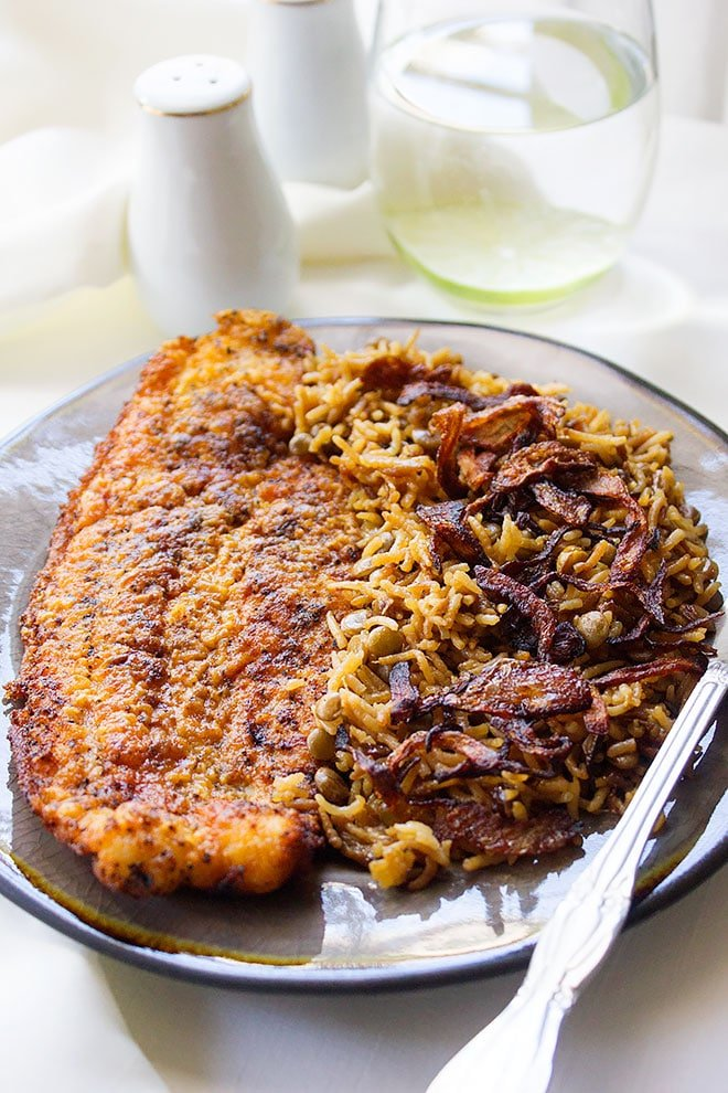 Fried fish served with Mujadara.