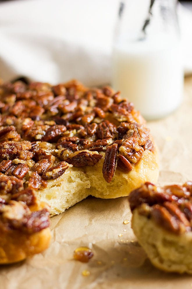 Fluffy dough of sticky cinnamon rolls with caramel and pecan.