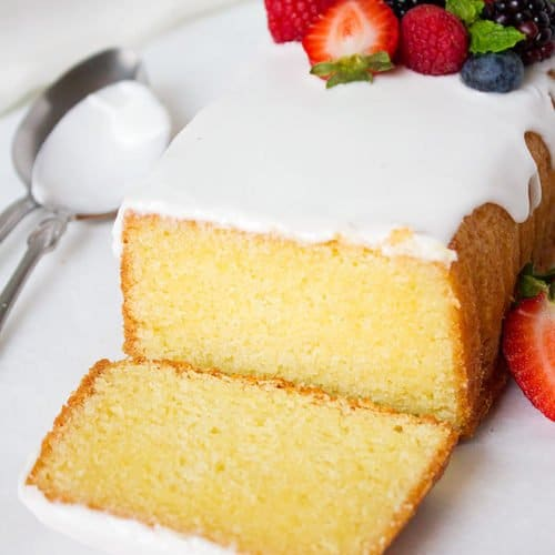 Golden Yellow cake. Moist and delicious yellow cake made from scratch. You'll never want to make yellow cake mix again! This recipe is for the best yellow cake recipe I ever tried and the yellow color is not artificial. www.munatycooking.com | @munatycooking
