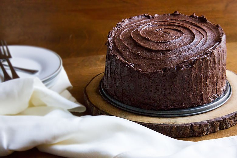 Round chocolate cake frosted with chocolate frosting.