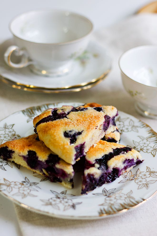 Blueberry scone ready to be eaten.