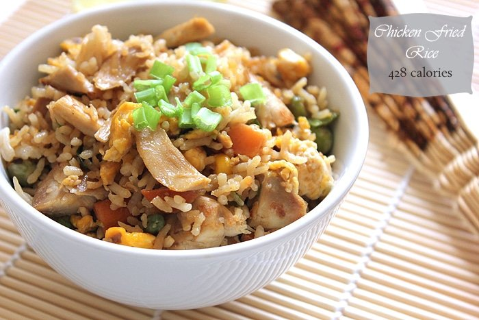 chicken egg fried rice in a white bowl.