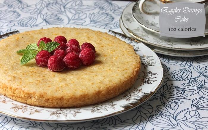 eggless orange cake served on a wide plate.