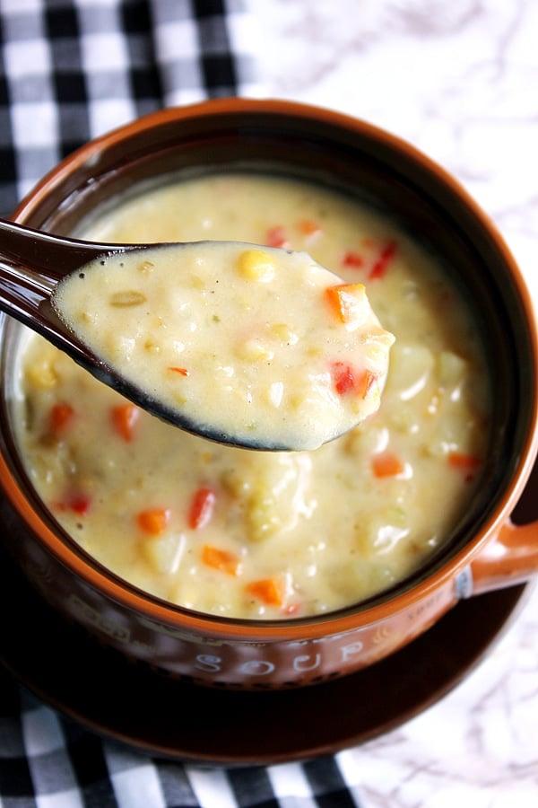 Pouring freekeh chowder soup.