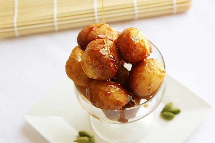 Crunchy Sweet Dumplings Luqaimat. Arabic sweet dumpling, prepared mostly in the month of Ramadan. Crunchy from the outside but soft inside. These luqaimat are deep fried, somewhat close to donuts. Date syrup is poured over it. www.munatycooking.com | @munatycooking
