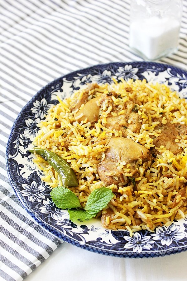 Side image of chicken biryani showing tender chicken thigh.