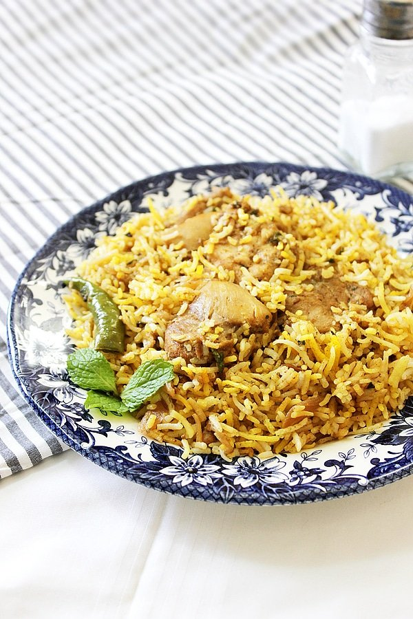 Close up image of chicken biryani in a plate.