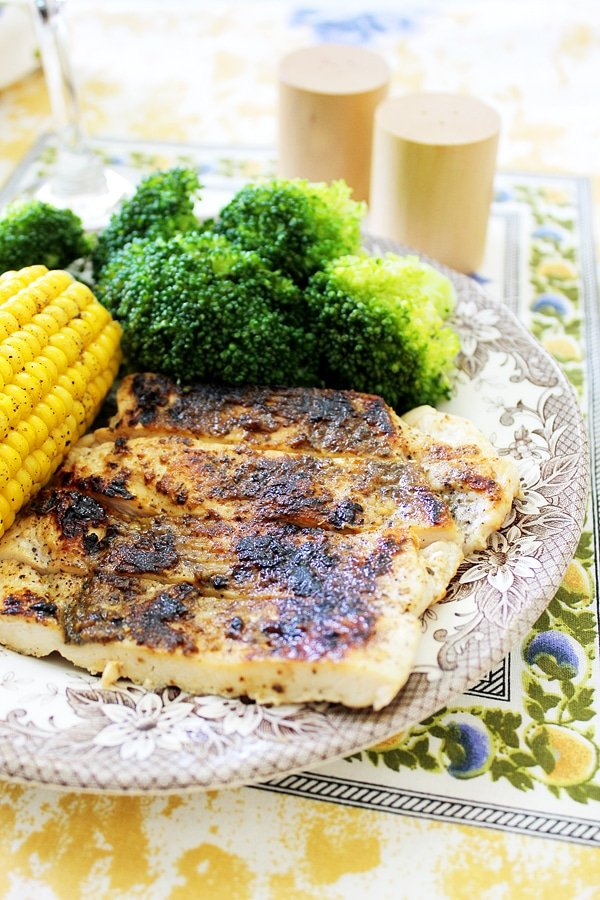 grilled chicken with corn on a plate