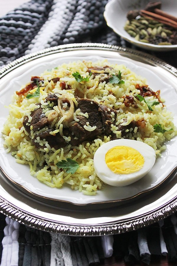 Fluffy biryani rice with tender lamb.