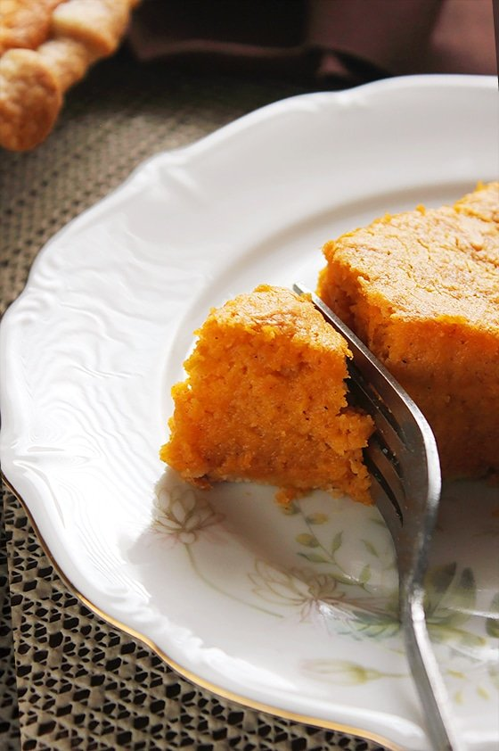 Close up shot of sweet potato pie slice.