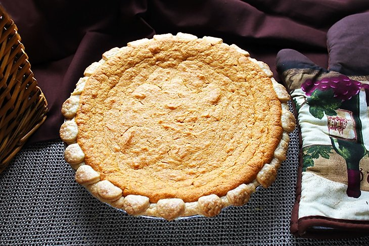 Freshly baked sweet potato pie served on a table.