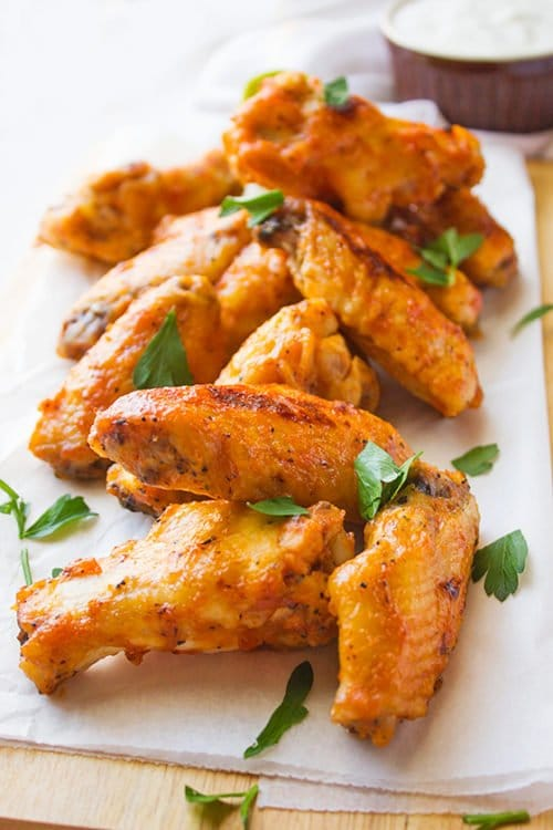 Close up image of juicy bbq chicken wings.