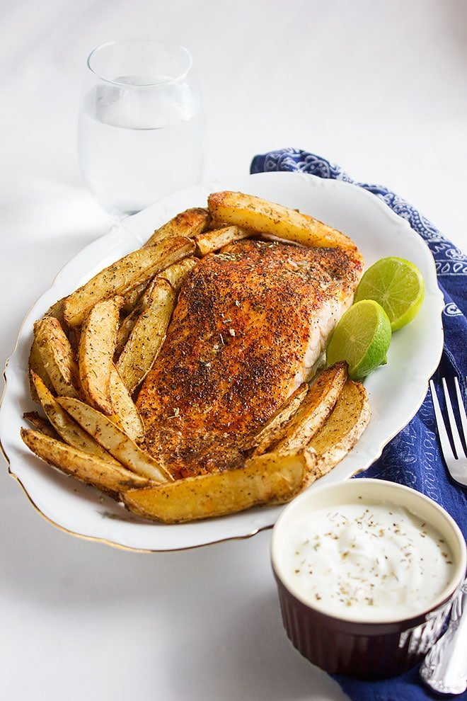 Baked salmon and seasoned potato wedges 1