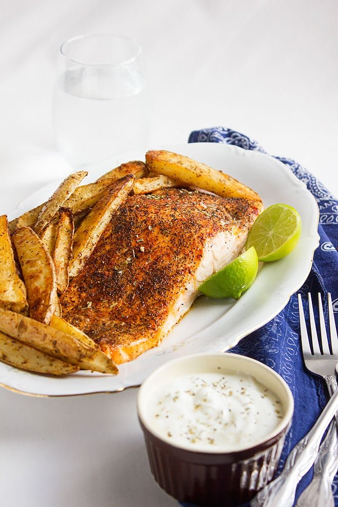 Baked salmon and seasoned potato wedges 2