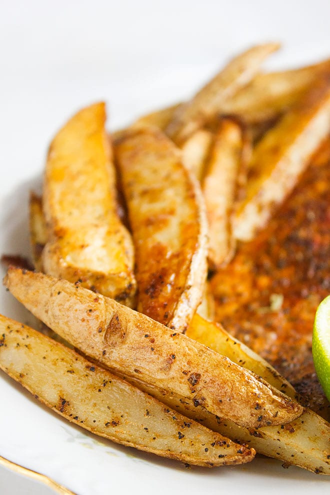 Baked salmon and seasoned potato wedges 3