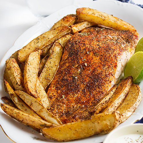 Baked salmon and seasoned potato wedges feature