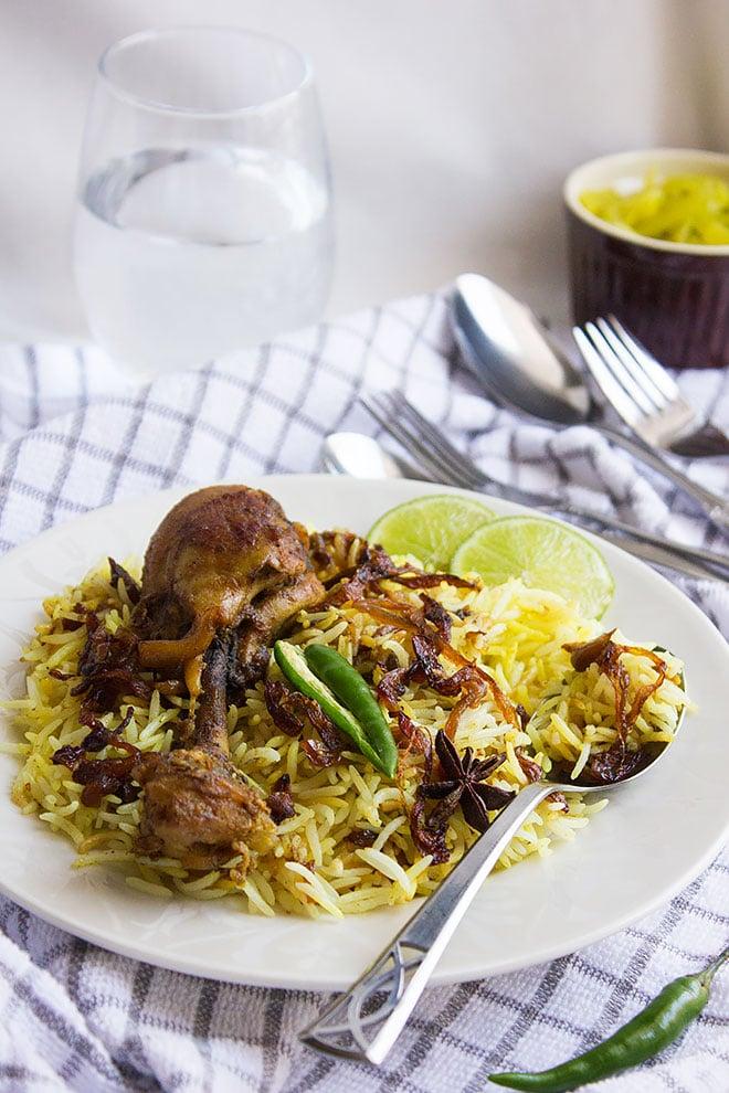 Hyderabadi chicken biryani with green chili on the side.