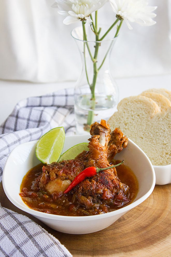 Jamaican Brown Stew Chicken. A popular and delicious Jamaican chicken stew. This stew is served with bread or white rice. Visit the post and learn how to make a flavorful Jamaican dish. www.munatycooking.com | @munatycooking