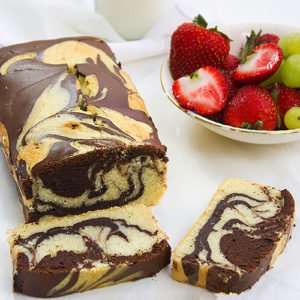 Marble pound cake recipe. A combination of two amazing flavors, authentic pound cake and fudge chocolate cake. This is one of the amazing versions of pound cake that I enjoy making for my family. www.munatycooking.com | @munatycooking #poundcake