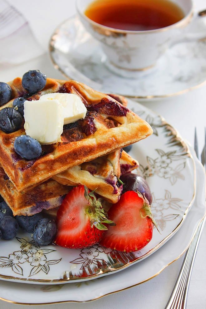 blueberry waffles served with strawberries