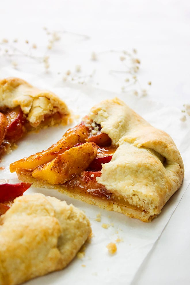 Side image of peach galette slice.