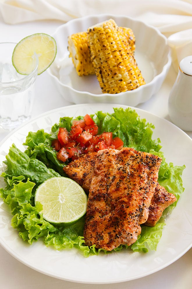 Grilled Spicy Salmon. The salmon is cooked until flaky. Lightly seasoned but bursting with flavor, this grilled salmon recipe will become your favorite. Learn how to grill salmon in easy steps. www.munatycooking.com | @munatycooking.