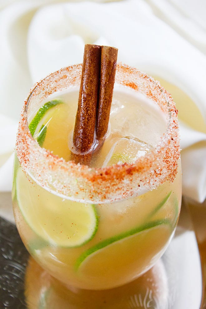 Apple Cider drink with a stick of cinnamon.