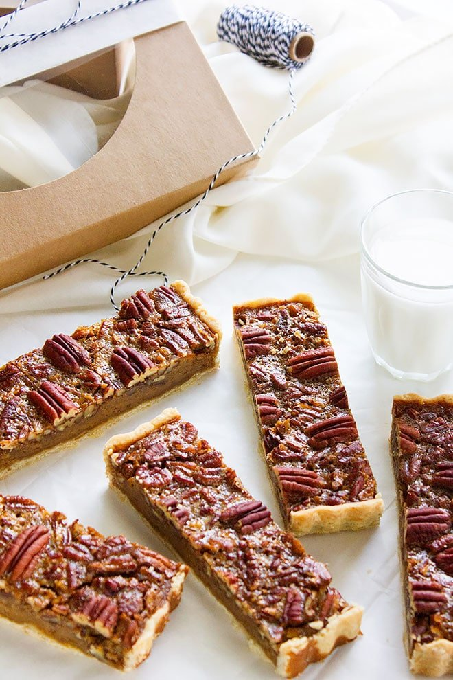 pecan pie bars with glass of milk on the side.