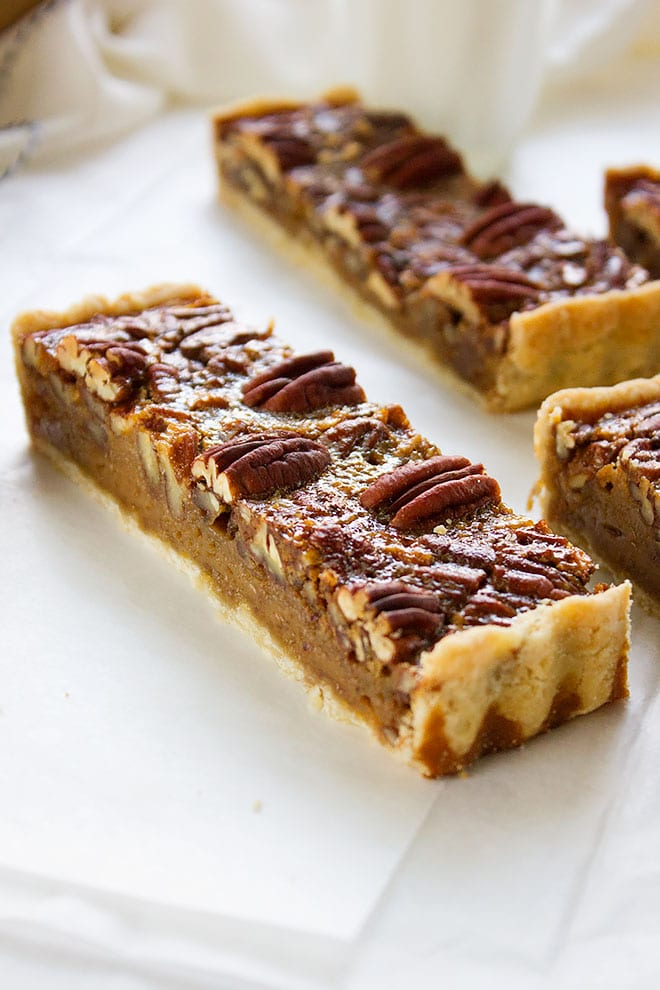 Close up shot of pecan pie bar.