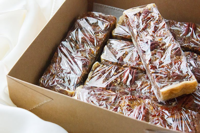 Wrapped pecan pie bars in a paper box.