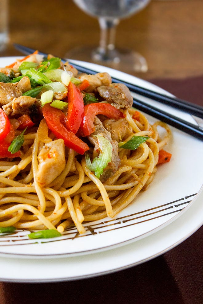Close up image of indo chinese dish Chicken Schezwan Noodles served.