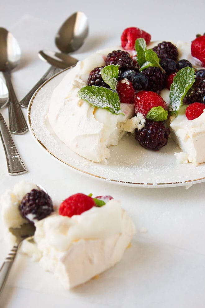 A slice is taken from the classic pavlova.