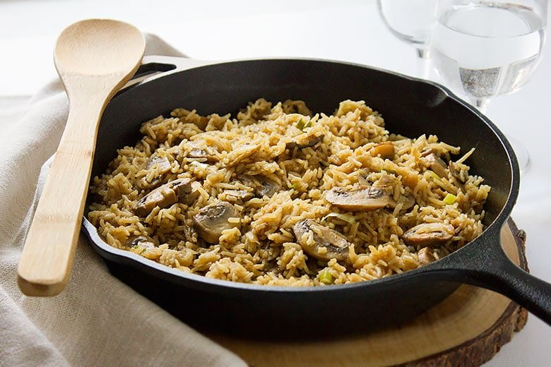 Cast iron full of delicious Mushroom and rice ready to be eaten.