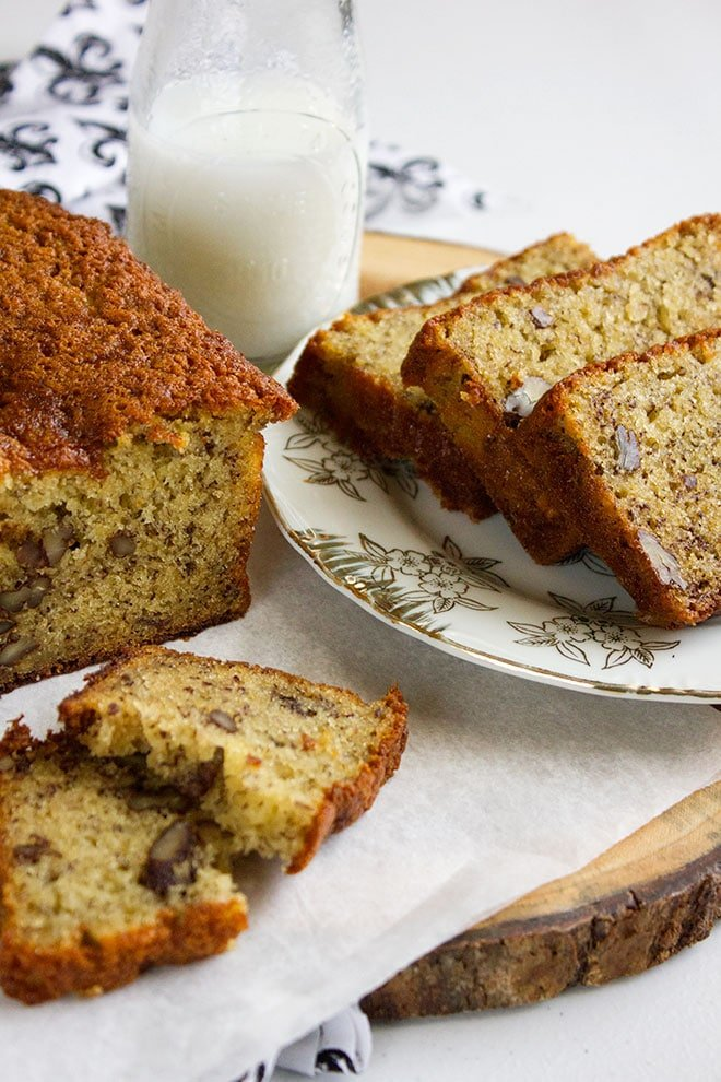 Banana Bread loaf and slices on the side.