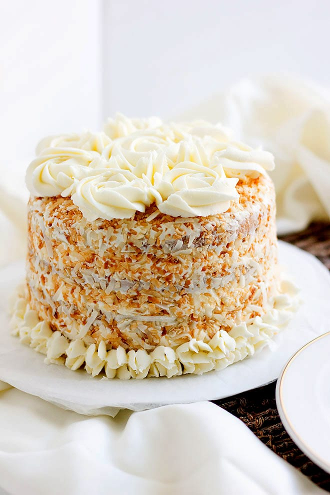 A full shot of Coconut Cake with frosting.