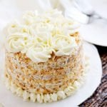 Coconut Cake recipe made from scratch with silky smooth buttercream frosting. My all-time favorite coconut cake recipe. Tender, delicious, moist coconut delight. Make it and let me know how you liked it. www.munatycooking.com   @munatycooking #coconutcake