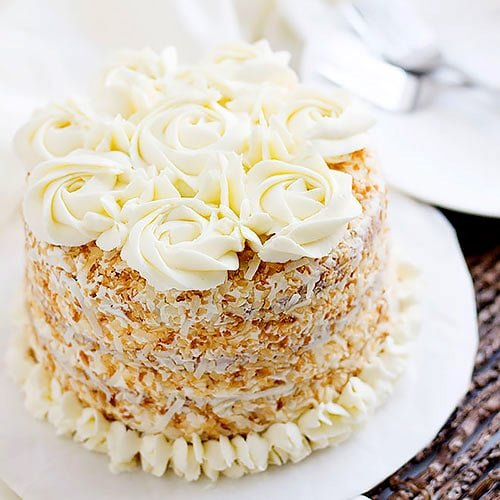 Coconut Cake recipe made from scratch with silky smooth buttercream frosting. My all-time favorite coconut cake recipe. Tender, delicious, moist coconut delight. Make it and let me know how you liked it. www.munatycooking.com | @munatycooking #coconutcake