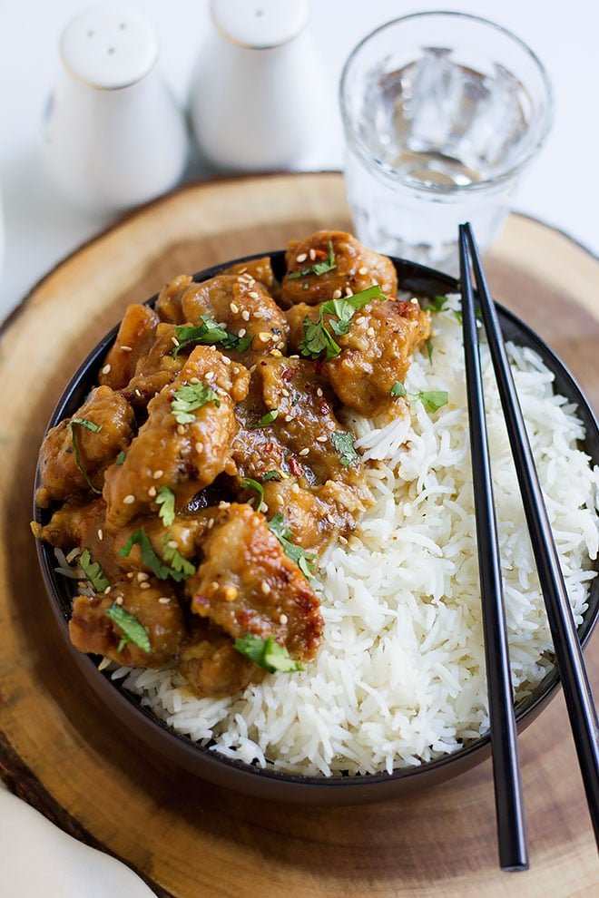 Head shot of Honey Garlic Chicken with chopstick on the side. #chickenrecipe #dinneridea #chicken