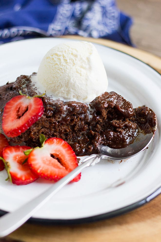 chocolate self saucing pudding served n a while plate. #chocolate #sauce #chocolatesauce #pudding #dessert