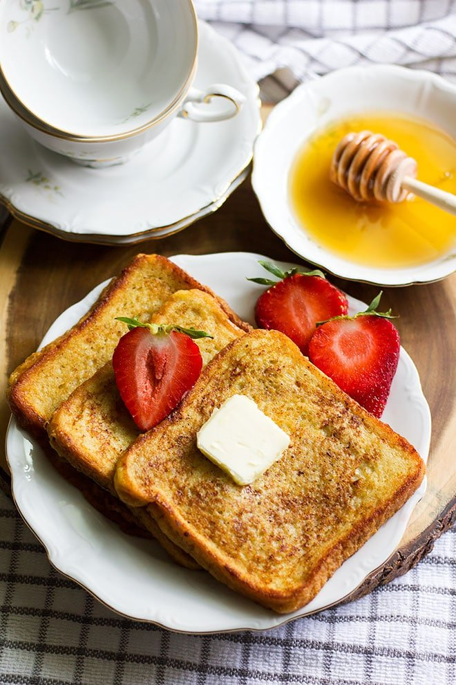 over head shot of french toast with honey and butter.