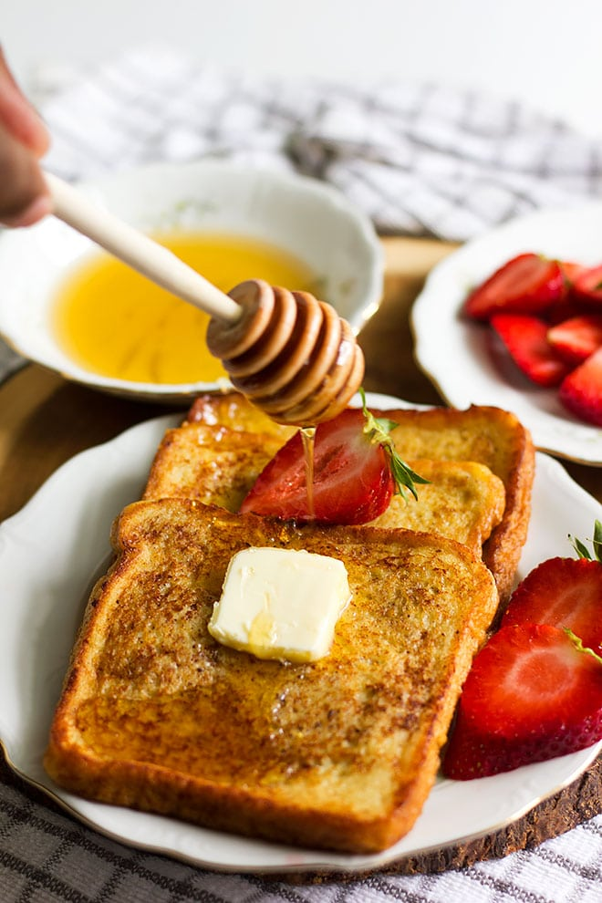 french toast drizzled by honey.