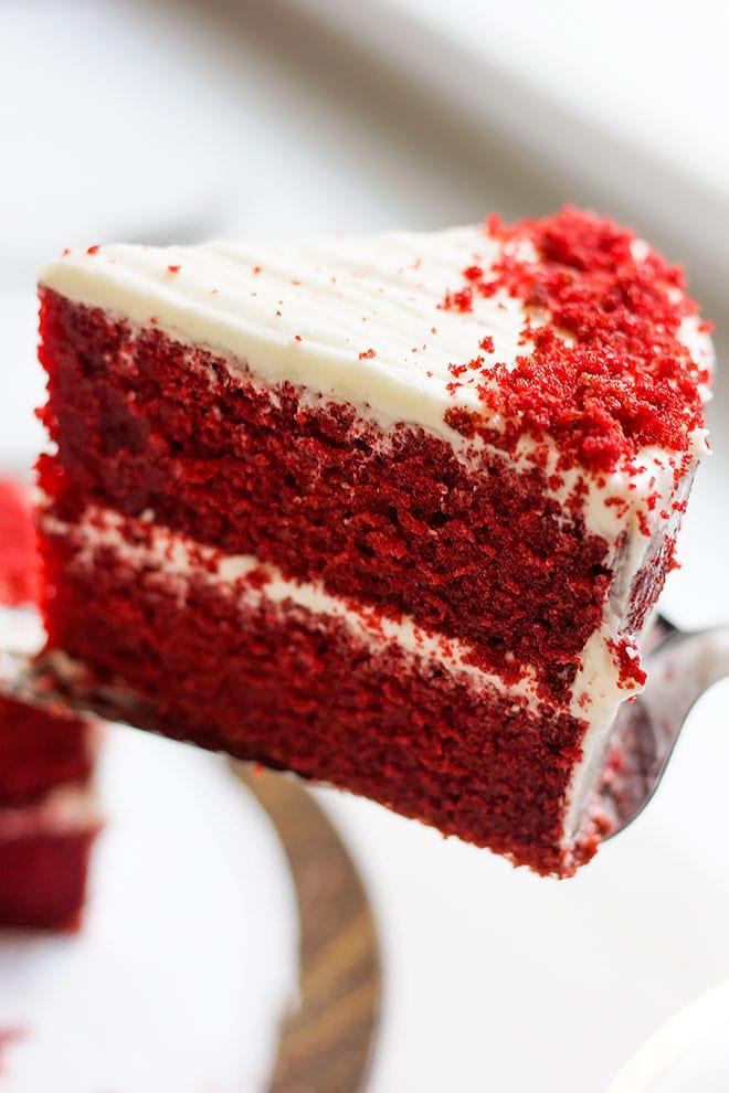 Close up image of red velvet cake slice.