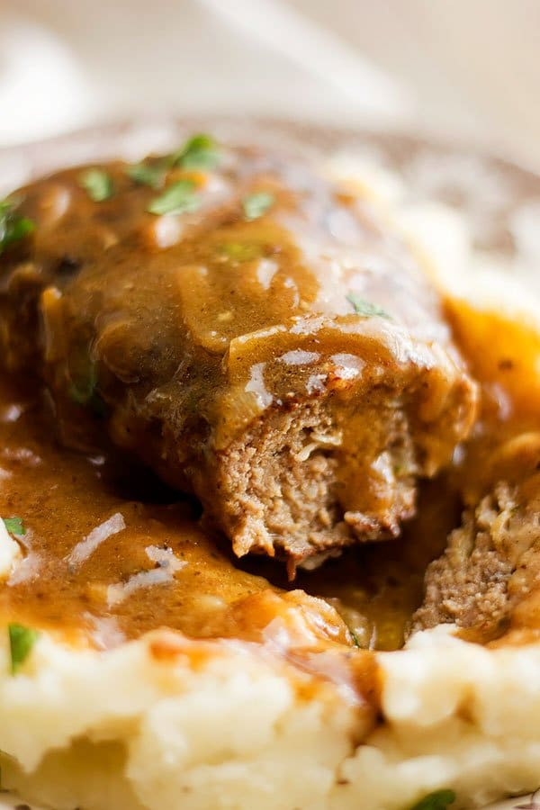 Close up shot of Salisbury steak showing how juicy it is.